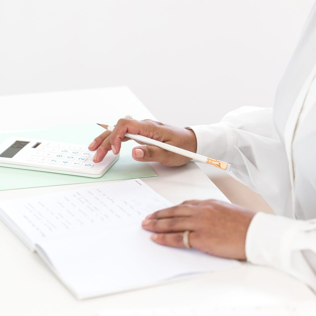 woman calculating and journaling