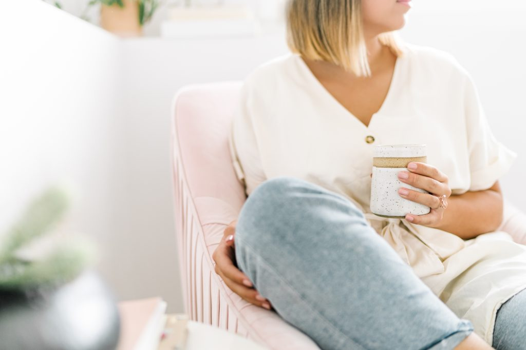 woman sitting and drinking coffee